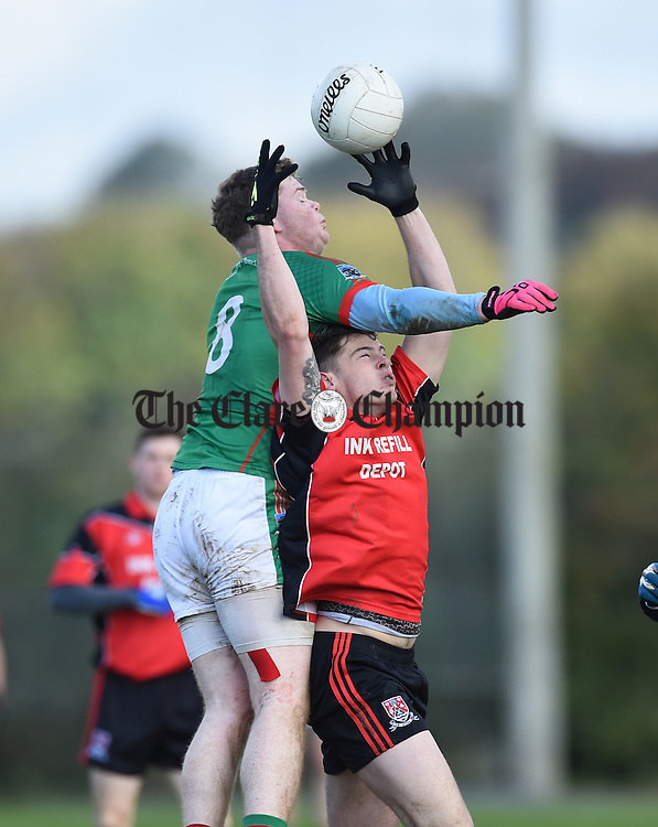 Keith Sexton of Kilmurry Ibrickane  in action against Cian Killeen of Meelick during their Junior A  county final at Gurteen. Photograph by John Kelly.