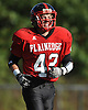 Plainedge cornerback No. 42 Ryan McGrane heads off the field after his team's defense forced Lawrence to punt in the fourth quarter of a Nassau County Conference III varsity football game at Plainedge High School on Saturday, October 17, 2015. Plainedge won 38-0.<br /> <br /> James Escher