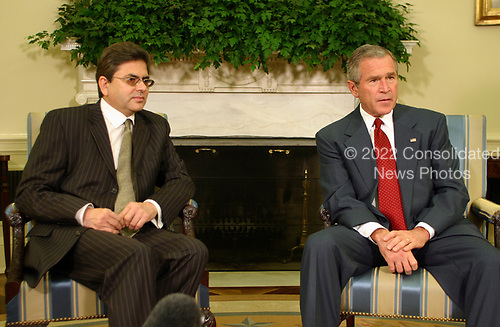 """Washington, DC - October 9, 2005 -- United States President George W. Bush meets with Mohammad Sadiq, Deputy Chief of Mission of the Pakistan Embassy.  The President stated in his remarks:  """" I would like to thank the Pakistan Embassy for coming by to brief me on the tragedy that has taken place in that country.  I was just told that this is going to be the worst natural disaster in the nation's history;  thousands of people have died; thousands are wounded, and the United States of America wants to help.  I spoke to President Musharraf.  I expressed our nation's deepest condolences.  And I told him that we want to help in any way we can.  To that end, we've already started to send cash money and other equipment and goods that is going to be needed to help the people in Pakistan.  Moving eight choppers over; the Chargé told me that one of the biggest concerns for the government of Pakistan is not enough airlift capacity to get to some of these rural areas where people are suffering.  So we're moving choppers. Secretary Rumsfeld is surveying the assets that he may be able to move in the area.  We're working with Pakistan at all levels of government.  Pakistan is a friend of the United States government and the people of the United States will help as best as we possibly can.  So I appreciate you coming by. Finally, as I told the President -- President Musharraf -- I said there are a lot of Americans who will be asking for the Almighty God's blessings on the people of Pakistan. Thank you all.""""<br /> Credit: Gary Fabiano - Pool via CNP"""