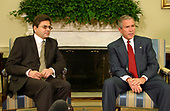 "Washington, DC - October 9, 2005 -- United States President George W. Bush meets with Mohammad Sadiq, Deputy Chief of Mission of the Pakistan Embassy.  The President stated in his remarks:  "" I would like to thank the Pakistan Embassy for coming by to brief me on the tragedy that has taken place in that country.  I was just told that this is going to be the worst natural disaster in the nation's history;  thousands of people have died; thousands are wounded, and the United States of America wants to help.  I spoke to President Musharraf.  I expressed our nation's deepest condolences.  And I told him that we want to help in any way we can.  To that end, we've already started to send cash money and other equipment and goods that is going to be needed to help the people in Pakistan.  Moving eight choppers over; the Chargé told me that one of the biggest concerns for the government of Pakistan is not enough airlift capacity to get to some of these rural areas where people are suffering.  So we're moving choppers. Secretary Rumsfeld is surveying the assets that he may be able to move in the area.  We're working with Pakistan at all levels of government.  Pakistan is a friend of the United States government and the people of the United States will help as best as we possibly can.  So I appreciate you coming by. Finally, as I told the President -- President Musharraf -- I said there are a lot of Americans who will be asking for the Almighty God's blessings on the people of Pakistan. Thank you all.""<br /> Credit: Gary Fabiano - Pool via CNP"