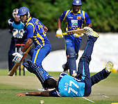 Cricket - ODI Summer Tri-Series - Scotland V Sri Lanka at Grange CC - Edinburgh - Scotland spinner Majid Haq tries in vain to stop the ball with Sri Lanka batsmen Dimuth Karumaratne and Thilina Kandamby looking for a run - Picture by Donald MacLeod - 13.07.11 - 07702 319 738 - www.donald-macleod.com