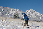 Caucasian male hiker after snowstorm, Flatirons rock formation, Chautauqua Park, Foothills, Boulder, Colorado, USA