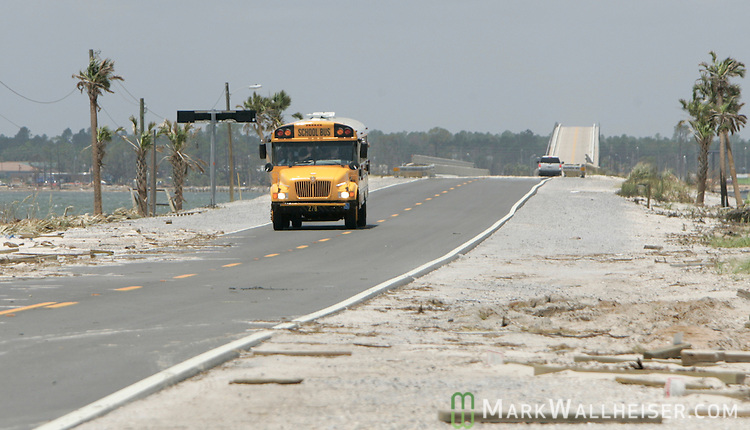 Residents of Navarre Beach, Florida are bussed over the bridge and onto the island July 11, 2005 so that they may check the condition of their homes.