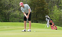 Fort Atkinson's Nate Gilbert putts on the 16th hole during boys high school golf on Wednesday, 5/15/13, at House on the Rock / The Springs Golf Course in Spring Green, Wisconsin