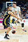 Real Madrid Luka Doncic and Iberostar Tenerife Tim Abromaitis during first match quarter finals of Liga Endesa Playoff between Real Madrid and Iberostar Tenerife at Wizink Center in Madrid, Spain. May 27, 2018. (ALTERPHOTOS/Borja B.Hojas)