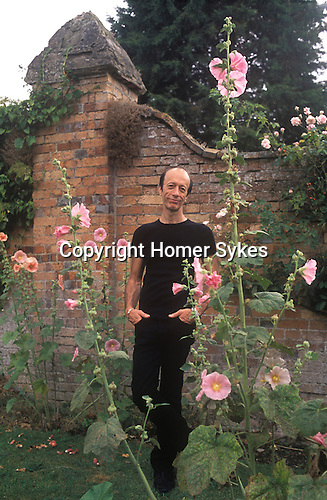 Robin Gibb of the pop group Bee Gees 2000s at their home in the Home Counties UK. Walled garden.