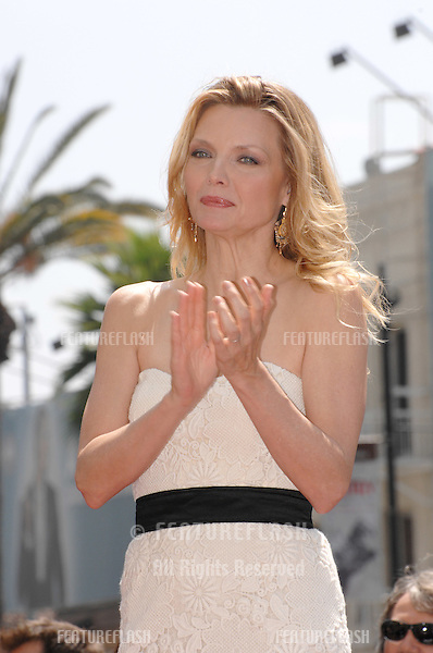 Michelle Pfeiffer on Hollywood Blvd where she was honoured with the 2,345th star on the Hollywood Walk of Fame..August 6, 2007  Los Angeles, CA.Picture: Paul Smith / Featureflash