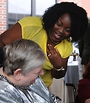 Irene Okwang, with guests at Greystone Programs' 27th Annual International Wine Showcase & Auction, held at The Grandview, in Poughkeepsie, NY, on Sunday, October 2, 2016. Photo by Jim Peppler; Copyright Jim Peppler 2016.