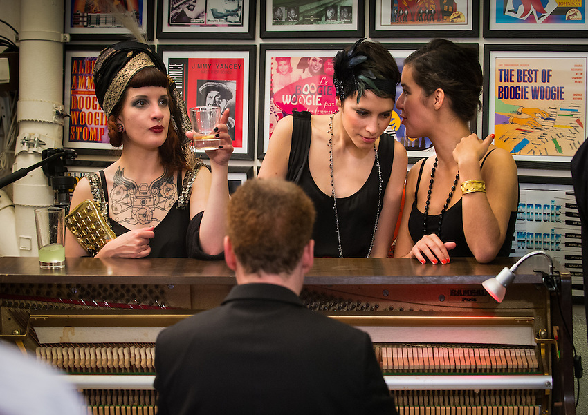 Gabrielle Leroux (centre) and Christophe Benz (piano) during an evening at Paris Boogie Speakeasy, the unique and exclusive club at 256 Rue Marcadet founded and run by Yves Riquet, director of Cervin Hosiery and official historian of the Crazy Horse. The evening was a tribute to Sidney Bechet, with outstanding music played by several pianists, clarinettists, saxophonist and drummer, including Lou Lauprète (piano), Christophe Benz (piano), Mokar Nirek (piano), Annie Terramosi (clarinet), and Gabrielle Janselme (singer). Also attending were Céline Pruvost (musician and singer), and Paul Loup Sulitzer. Paris Boogie Speakeasy has been credited by L'Express as being one of the most exciting places in Paris (l'un des spots les plus amusants de Paname!). Sunday 19th May 2013.