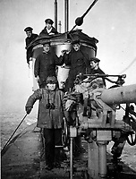 BNPS.co.uk (01202 558833)<br /> Pic Lawrences/BNPS<br /> <br /> G 14 crew on patrol -  Capt Bailward front left<br /> <br /> Fascinating early photos of submarine warfare featuring close quarters views of German battleships have come to light 100 years later.<br /> <br /> The photo albums were collated by British Commander Maurice Bailward who documented every stage of his naval career.<br /> <br /> Cmdr Bailward attended Royal Naval College in Osborne, Isle of Wight, from 1906 and 1908, the same time as Edward, the Prince of Wales.<br /> <br /> He was involved in many of the major sea battles of World War Two as well as the British effort to help the Whites during the Russian Civil War of 1919.<br /> <br /> The albums have emerged for sale at auction from a family descendant with Lawrences Auctioneers, of Crewkerne, Somerset.