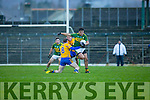 Wayne Gutrie Kerry powers past Cathal O'Connor Clare during the McGrath cup clash at Fitzgerald Stadium on Sunday