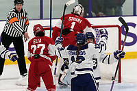 WORCESTER, MA - FEBRUARY 08: Mary Edmonds #13 of Holy Cross celebrates her goal with teammate during a game between Boston University and College of the Holy Cross at Hart Center Rink on February 08, 2020 in Worcester, Massachusetts.