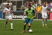 Sebastien Le Toux of the Seattle Sounders breaks through against Dema Kovalenko of the LA Galaxy at Quest Field on May 10, 2009. The Sounders and Galaxy played to a 1-1 draw.