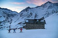 Ski tourers leaving the Martin Busch Hut during the Öztal ski tour, Austria
