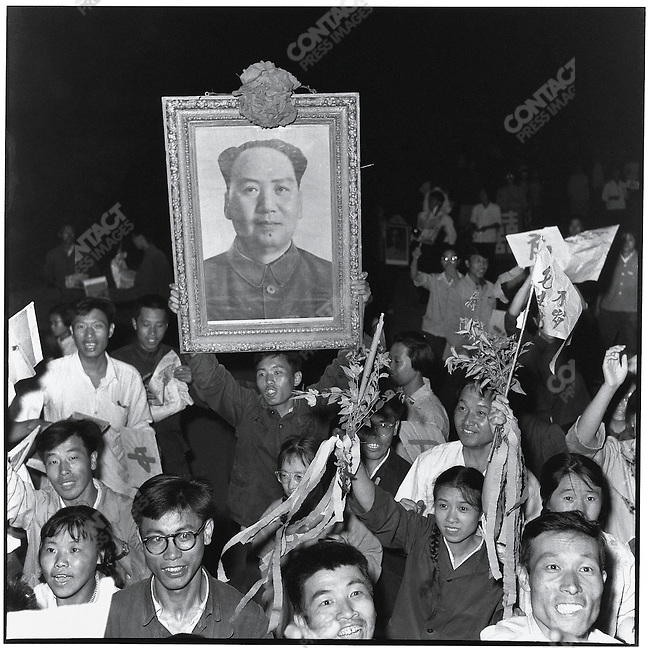 A joyous crowd takes to the streets at night after an official broadcast publicizes the contents of a big character poster hung on 25 May at Bejing University denouncing Party leaders at the school for failing to carry out the Cultural Revolution. Harbin, Heilongjiang province, 1 June 1966