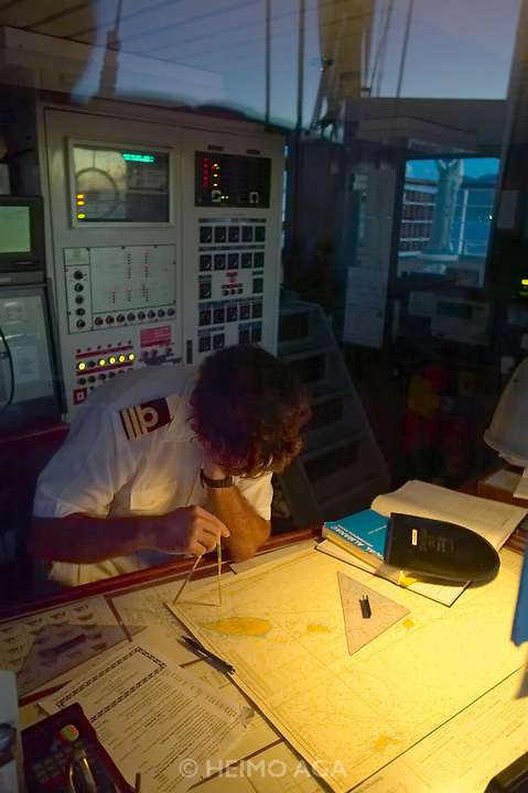 The Star Clipper reaching St. Kitts at dawn. 1st Officer Fernando checks the course.