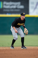 West Virginia Power shortstop Kevin Newman (5) on defense against the Hickory Crawdads at L.P. Frans Stadium on August 15, 2015 in Hickory, North Carolina.  The Power defeated the Crawdads 9-0.  (Brian Westerholt/Four Seam Images)