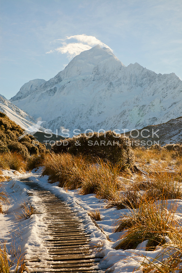 Snow covered boardwalk on the Hooker Valley track leading to Hooker Lake at Mount Cook / Aoraki