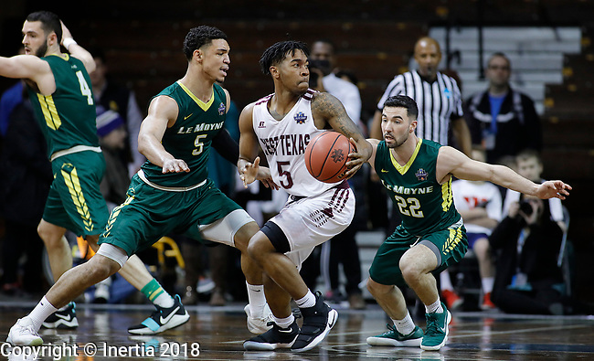 SIOUX FALLS, SD: MARCH 20:  Jordan Collins #5 of West Texas A&M drives into Le Moyne defenders Isaiah Eisendorf #5 and Anthony Richards #22 during their game at the 2018 Division II Men's Elite 8 Basketball Championship at the Sanford Pentagon in Sioux Falls, S.D. (Photo by Dick Carlson/Inertia)