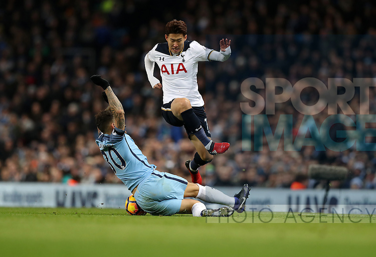 Son Heung-Min of Tottenham Hotspur and Nicolas Otamendi of Manchester City during the Premier League match at Etihad Stadium, Manchester. Picture date: January 21st, 2017.Photo credit should read: Lynne Cameron/Sportimage