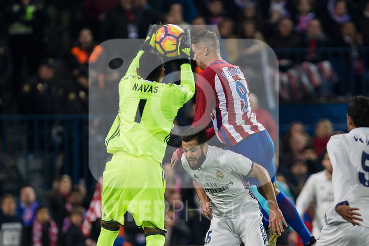 Real Madrid's Keylor Navas Raphael Varane Atletico de Madrid's Fernando Torres during the match of La Liga between Atletico de Madrid and Real Madrid at Vicente Calderon Stadium  in Madrid , Spain. November 19, 2016. (ALTERPHOTOS/Rodrigo Jimenez)