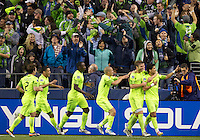 Seattle Sounders FC players celebrate a goal by forward Fredy Montero, far right, during play between the Seattle Sounders FC and the Chicago Fire in the U.S. Open Cup Final at CenturyLink Field in Seattle Tuesday October 4, 2011. Seattle won the game 2-0 to win its third U.S. Open Cup.