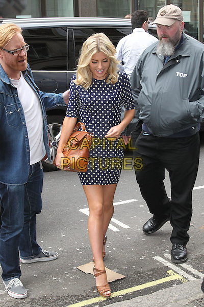 Mollie King.The Saturdays arrive at the studios of BBC Radio 1, London, England..April 16th, 2012.full length blue white polka dot dress brown clutch bag sandals .CAP/HIL.©John Hillcoat/Capital Pictures .