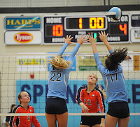 NWA Democrat-Gazette/ANDY SHUPE<br /> Hope Von Gremp (12) of Rogers Heritage sends the ball over the net as Klaire Trainor (22) and Jaden Williams (17) of Springdale Har-Ber defend Thursday, Sept. 17, 2015, at Wildcat Arena in Springdale. Visit nwadg.com/photos to see more photographs from the game.