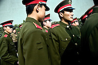 Army soldiers line up outside the Nanjing Massacre Memorial Museum in Nanjing, Jiangsu, China, on the 71st anniversary of the start of the Rape of Nanjing.