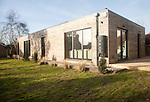 Oak panelling walls of modern newly built sustainable house called Greentithe at Snape, Suffolk, England