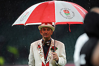 Peter Cross keeps the rain off after the QBE International match between England and New Zealand at Twickenham Stadium on Saturday 8th November 2014 (Photo by Rob Munro)