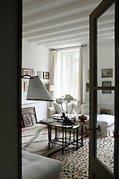 In the small salon the rugs are Moroccan and the loose covers on the daybeds are of cool white linen