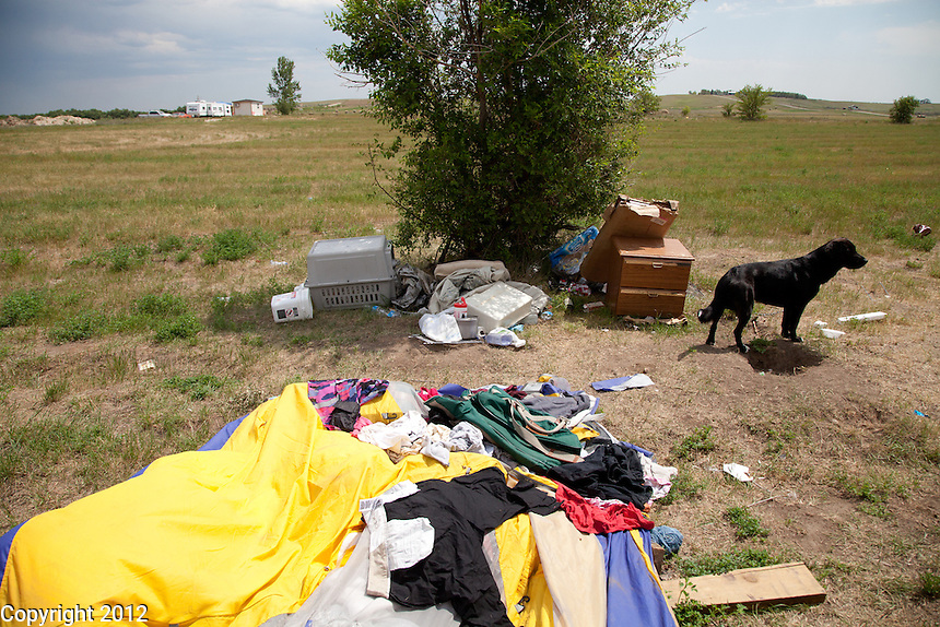 After Wendy and Kira moved out of their tent, pictured here, it ended up becoming a mess of wet clothes and dogs used it as a bathroom. Much of it needed to be thrown out. Some was saved and washed.