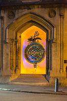 "UK, England, Cambridge.  Corpus Clock, Corpus Christi College, under Nightime Illumination.  ""Chronophage"" on top, ""eater of time"", a giant grasshopper.  Dedicated 2008."