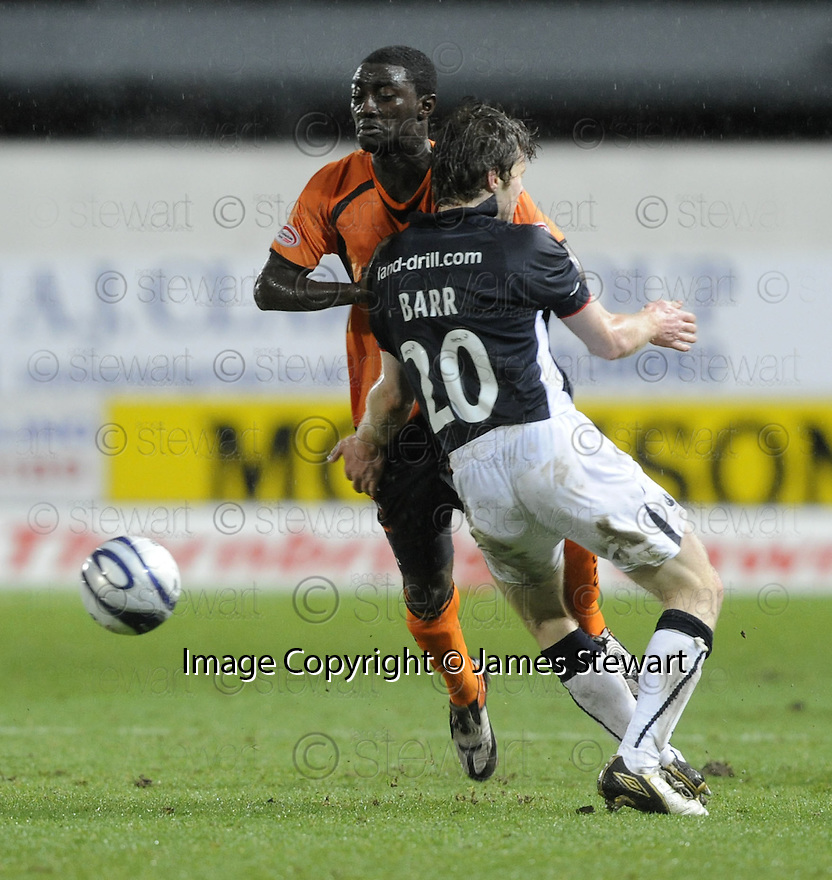 03/03/2009  Copyright Pic: James Stewart.File Name : sct_jspa16_falkirk_v_dundee_utd.DARREN BARR BLOCKS MORGARO GOMIS.James Stewart Photo Agency 19 Carronlea Drive, Falkirk. FK2 8DN      Vat Reg No. 607 6932 25.Studio      : +44 (0)1324 611191 .Mobile      : +44 (0)7721 416997.E-mail  :  jim@jspa.co.uk.If you require further information then contact Jim Stewart on any of the numbers above.........