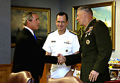 Washington, DC - August 31, 2007 -- Admiral Mike Mullen (center), Chief of Naval Operations, looks on as United States President George W. Bush, left, greets Marine General James T. Conway, Commandant of the Marine Corps, right,  at the Pentagon on Friday, August  31, 2007. <br /> Mandatory Credit: Cherie A. Thurlby - DoD via CNP