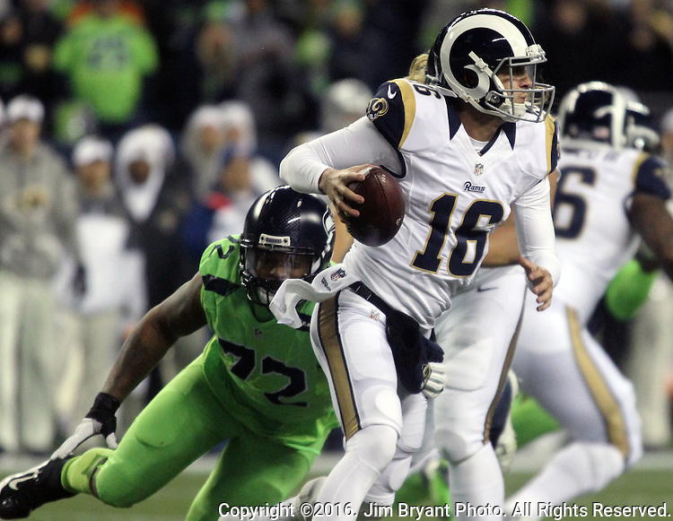 Los Angeles Rams quarterback Jared Goff (16) scrambles away from Seattle Seahawks defensive end Michael Bennett (72) at CenturyLink Field in Seattle, Washington on December 15, 2016.  The Seahawks beat the Rams 24-3.   ©2016. Jim Bryant Photo. All Rights Reserved