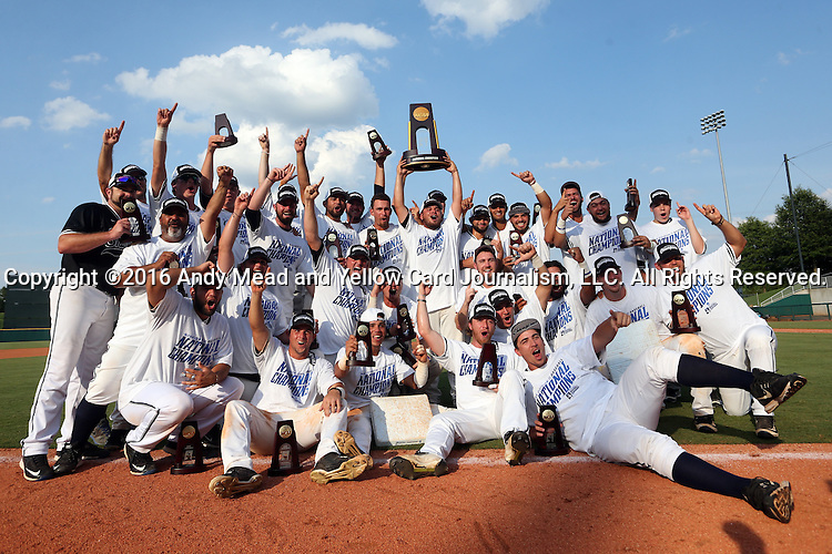 04 June 2016: Nova Southeastern players and coaches pose with the championship trophy. The Nova Southeastern University Sharks played the Millersville University Marauders in Game 14 of the 2016 NCAA Division II College World Series  at Coleman Field at the USA Baseball National Training Complex in Cary, North Carolina. Nova Southeastern won the game 8-6 and clinched the NCAA Division II Baseball Championship.