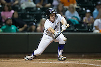 Toby Thomas (4) of the Winston-Salem Dash attempts to lay down a bunt against the Potomac Nationals at BB&T Ballpark on May 13, 2016 in Winston-Salem, North Carolina.  The Dash defeated the Nationals 5-4 in 11 innings.  (Brian Westerholt/Four Seam Images)