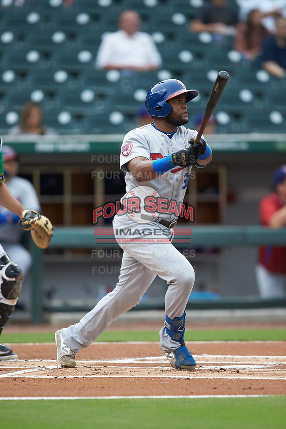 Socrates Brito (51) of the Buffalo Bisons follows through on his swing against the Caballeros de Charlotte at BB&T BallPark on July 23, 2019 in Charlotte, North Carolina. The Bisons defeated the Caballeros 8-1. (Brian Westerholt/Four Seam Images)