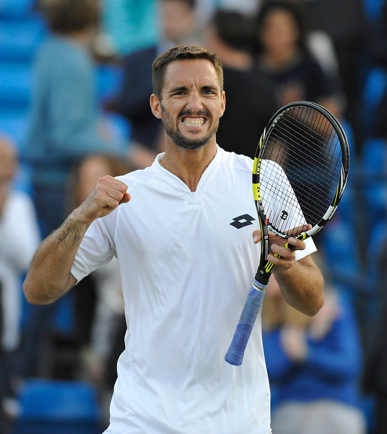 Viktor Troicki (SRB) celebrates his victory over John Isner (USA) in their Men&rsquo;s Singles Quarter Final match - Viktor Troicki (SRB) def John Isner (USA) 7-6, 6-3<br /> <br /> <br /> Photographer Ashley Western/CameraSport<br /> <br /> Tennis - ATP 500 World Tour - AEGON Championships- Day 5 - Friday 19th June 2015 - Queen's Club - London <br /> <br /> &copy; CameraSport - 43 Linden Ave. Countesthorpe. Leicester. England. LE8 5PG - Tel: +44 (0) 116 277 4147 - admin@camerasport.com - www.camerasport.com