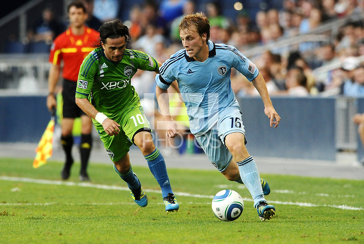 Seth Sinovic (16) defender Sporting KC goes past Mauro Rosales (10) midfielder Seattle Sounders... Sporting Kansas City were defeated 1-2 by Seattle Sounders at LIVESTRONG Sporting Park, Kansas City, Kansas.