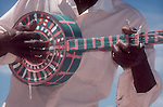 Dominican Republic, Cabarete, Beach musician, homemade banjo, Caribbean, West Indies,