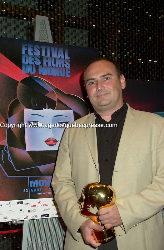 Sept 2, 2002, Montreal, Quebec, Canada<br /> <br /> Carlos Saura' s son Antonio Saura, Producer (L) accept the Best Artistic Contribution for Saura's film SALOME<br /> at the closing ceremony of the 2002 Montreal World Films Festival, Sept 2 2002, in  Montreal, Quebec, Canada<br /> <br /> <br /> Mandatory Credit: Photo by Pierre Roussel- Images Distribution. (&copy;) Copyright 2002 by Pierre Roussel <br /> <br /> NOTE : <br />  Nikon D-1 jpeg opened with Qimage icc profile, saved in Adobe 1998 RGB<br /> .Uncompressed  Uncropped  Original  size  file availble on request.