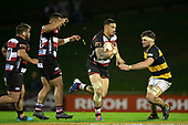 Sonny Bill Williams makes a break past Lachlan Boshier. Mitre 10 Cup rugby game between Counties Manukau Steelers and Taranaki Bulls, played at Navigation Homes Stadium, Pukekohe on Saturday August 10th 2019. Taranaki won the game 34 - 29 after leading 29 - 19 at halftime.<br /> Photo by Richard Spranger.