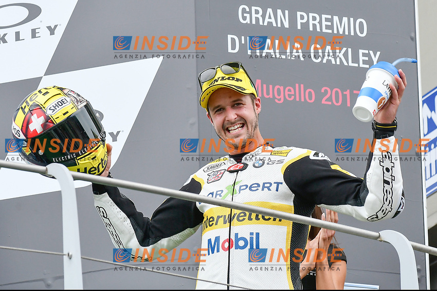 SCARPERIA,FLORENCE, ITALY - JUNE 04:,2017 Thomas Luthi of Switzerland and CarExpert Interwetten (Moto2) celebrates on the podium his second place at the end race MotoGP during  MotoGP Gran Premio d'Italia- at Mugello Circuit. on june 04, 2017 in Scarperia Italy.<br /> Photo Marco Iorio/Insidefoto