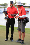 Wearing Think Tank Photo gear is PGA photographer Stan Badz with Tiger Woods during the trophy presentation at the WGC-Cadillac held at Doral.