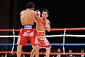 (L-R) Terdsak Kokietgym (THA), Takahiro Aou (JPN),.APRIL 6, 2012 - Boxing :.Takahiro Aou of Japan in action against Terdsak Kokietgym of Thailand during the WBC super featherweight title bout at Tokyo International Forum in Tokyo, Japan. (Photo by Mikio Nakai/AFLO)
