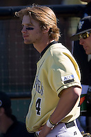 Evan Ocheltree (4) of the Wake Forest Demon Deacons watches the action from the home dugout versus the Clemson Tigers during the second game of a double header at Gene Hooks Stadium in Winston-Salem, NC, Sunday, March 9, 2008.  The Tigers defeated the Demon Deacons 12-11.