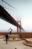 USA, California, San Francisco, tourists on the rooftop of the Fort Point National Historic site beneath the Golden Gate Bridge